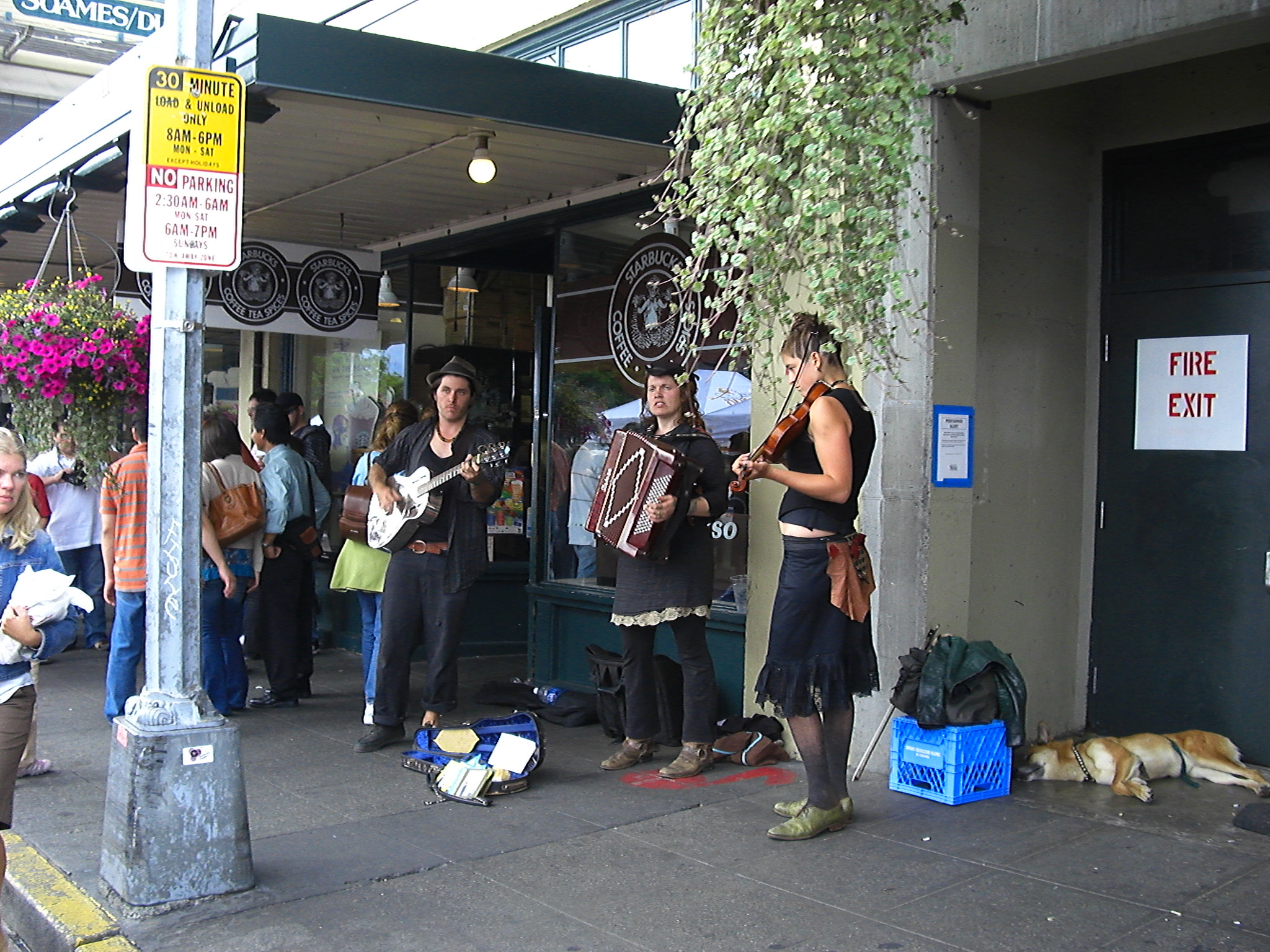 Street performers at the original Starbucks Coffee Pike Place Market Seattle